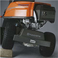 Husqvarna R316T rider lawnmower showing the rear pivot axle in action